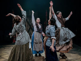 Image from Ballad of Maria Marten showing a group of of women dancing joyously with hands in the air